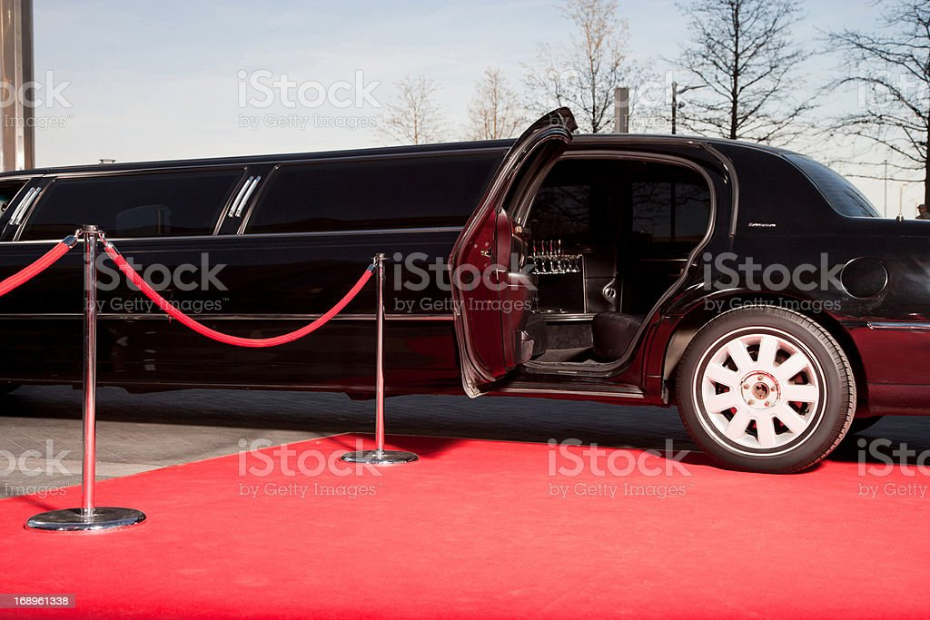 Limo with open door on red carpet stock photo