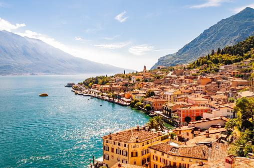 Limone Sul Garda cityscape on the shore of Garda lake surrounded by scenic Northern Italian nature. Amazing Italian cities