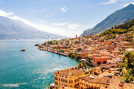 Limone Sul Garda cityscape on the shore of Garda lake surrounded by scenic Northern Italian nature. Amazing Italian cities