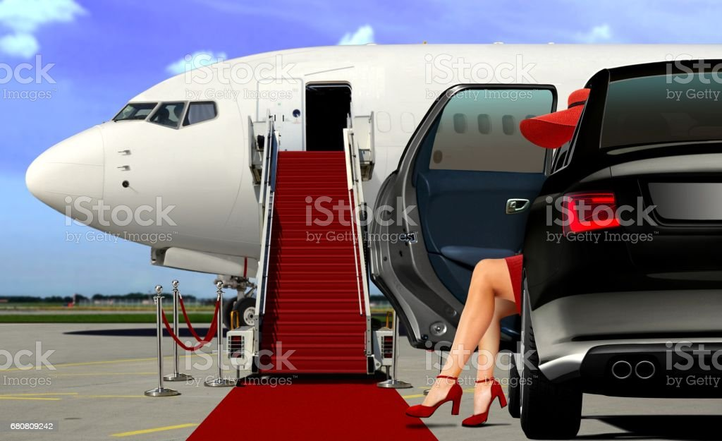 Limousine arrival at the airport with red carpet stock photo