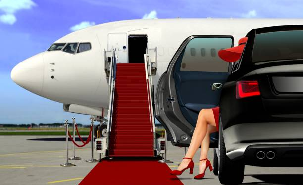Limousine arrival at the airport with red carpet lady in red arrival with red carpet before boarding an airplane upper class stock pictures, royalty-free photos & images