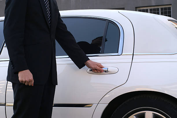 limousine driver - limousine service stock photos and pictures