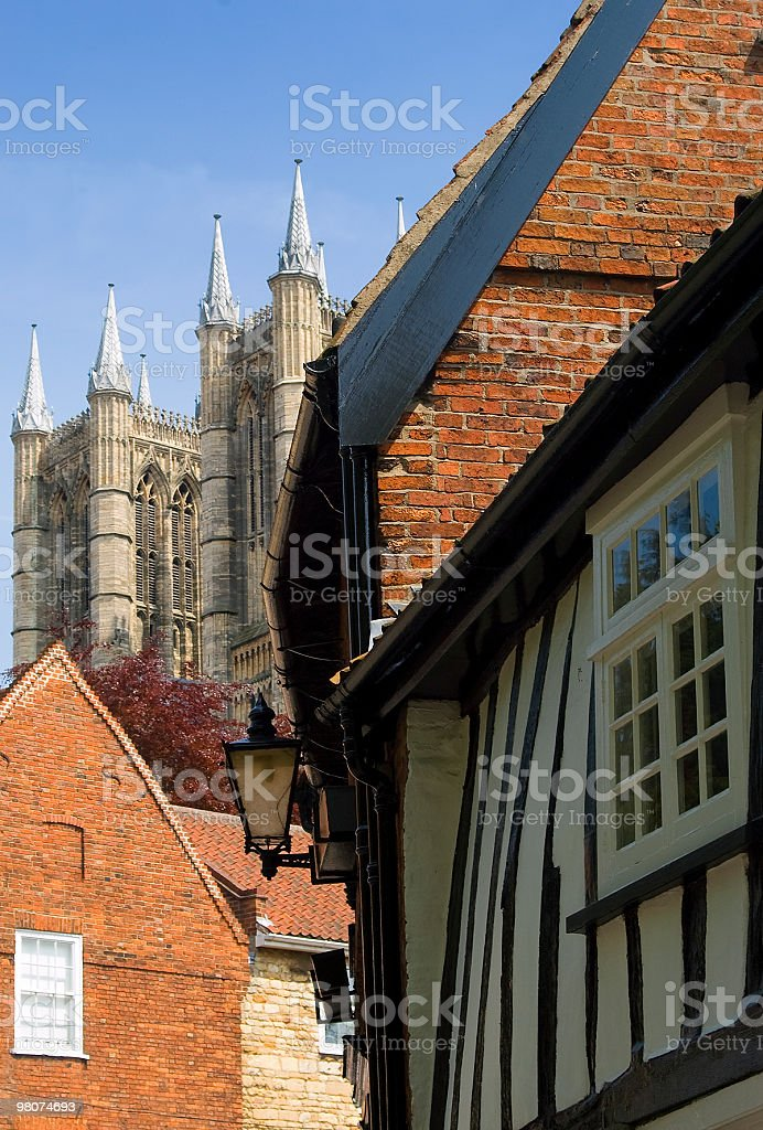 Lincoln cathedral and 16th century Tudor house, England royalty-free stock photo