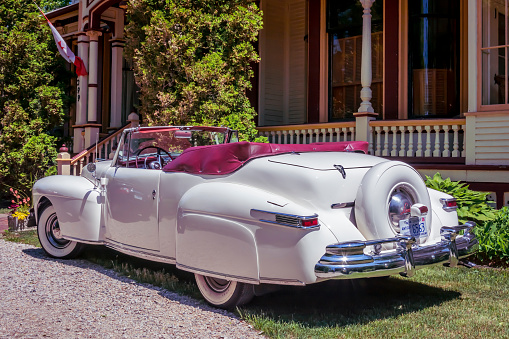Windsor, Nova Scotia, Canada - June 19, 2016 : 1948 Lincoln convertible parked in front of the popular bed & breakfast, Clockmaker's Inn, Windsor, Nova Scotia, Canada.