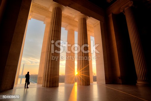 Businessman inside Lincoln Memorial at sunrise
