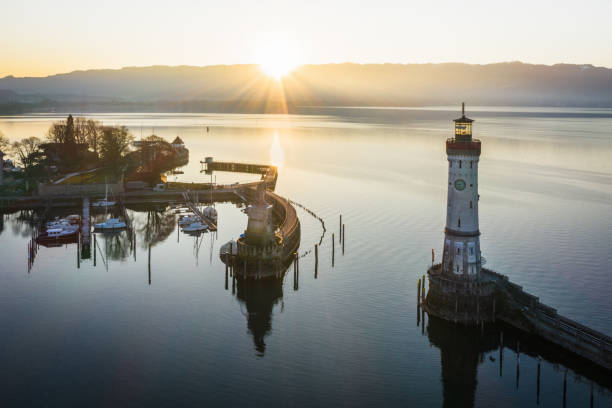 Lindau at Sunrise Bodensee Harbor Bavaria Germany Sunrise over Bodensee Harbor Entrance of Lindau with the famous Lighthouse and Bavarian Lion Sculpture (from the year 1856). Sunrise, Aerial Drone point of View. Lindau, Bodensee, Bavaria, Germany. Bodensee stock pictures, royalty-free photos & images