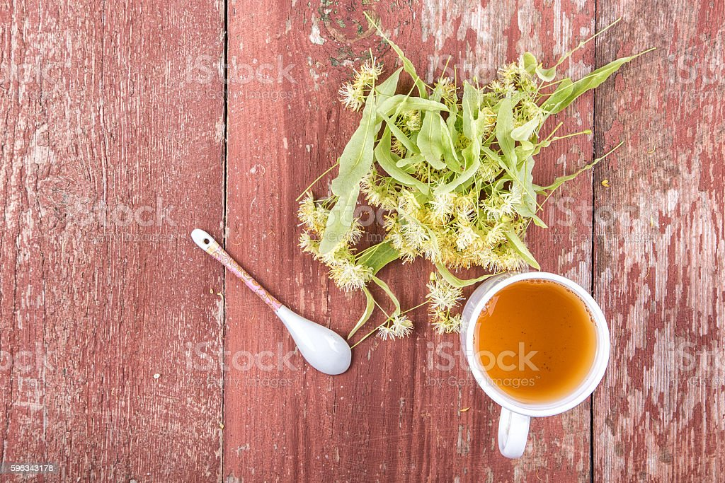 Linden tea in a cup on a wooden background. royalty-free stock photo