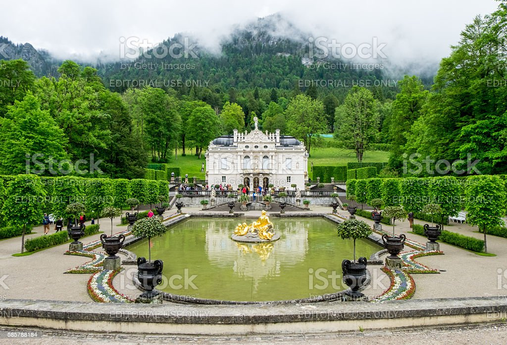 Linderhof palace and fountain in garden stock photo