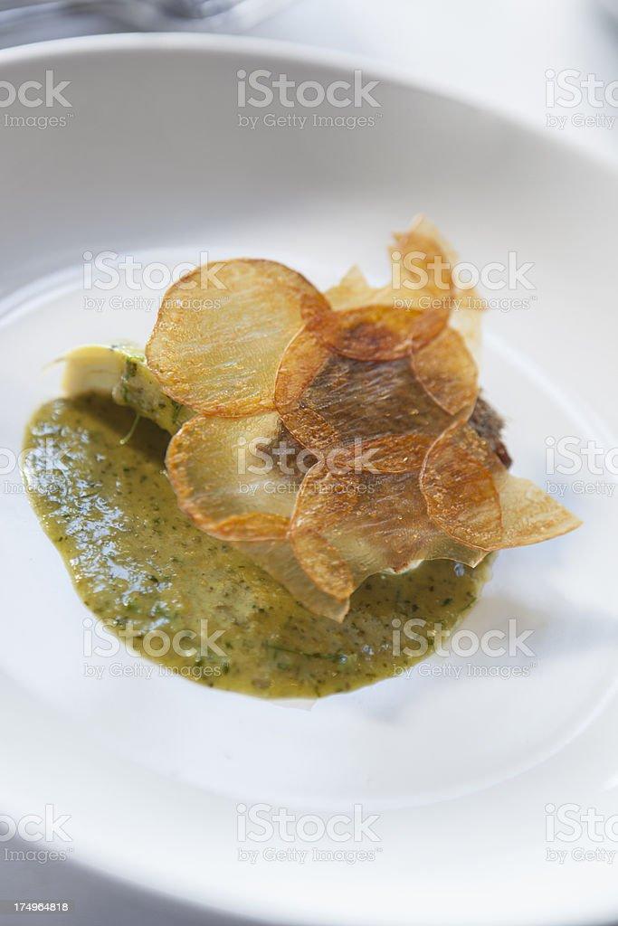 Line caught snapper fillet, crispy potato, nettle & sorrel butter royalty-free stock photo