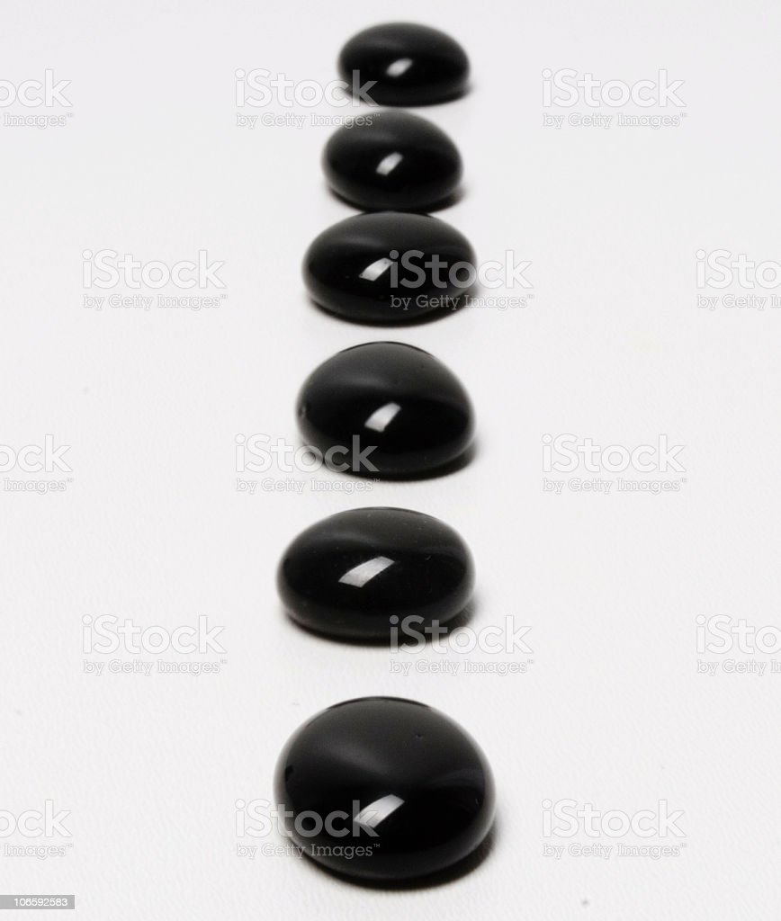 line of black stones royalty-free stock photo