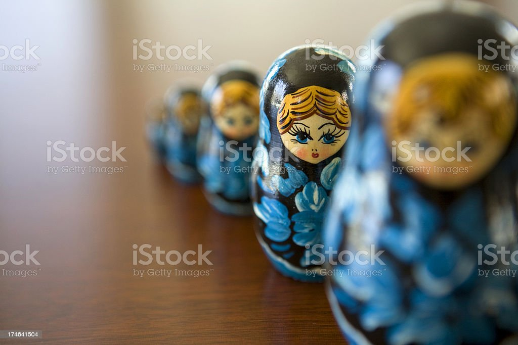 Line of blue matryoshka dolls with focus on the second doll stock photo
