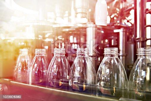 Line of bottling beverages in plastic bottles on factory