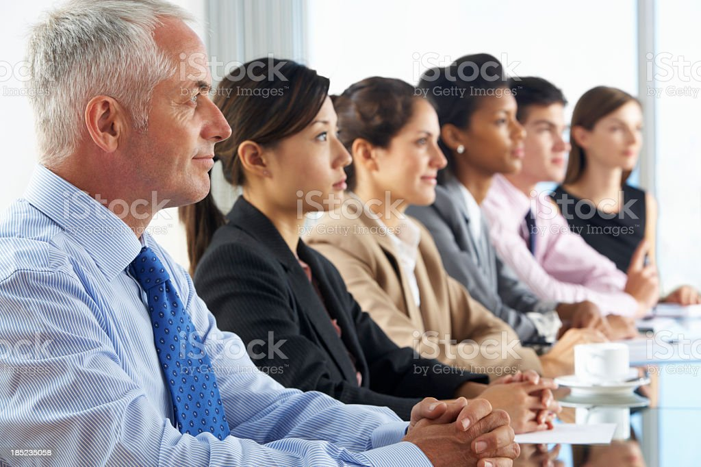 Line Of Business People Listening To Presentation royalty-free stock photo