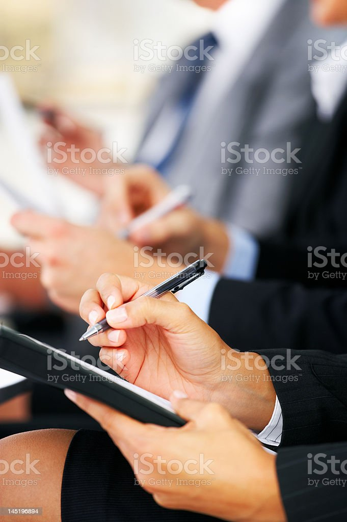 Line of business people taking notes royalty-free stock photo