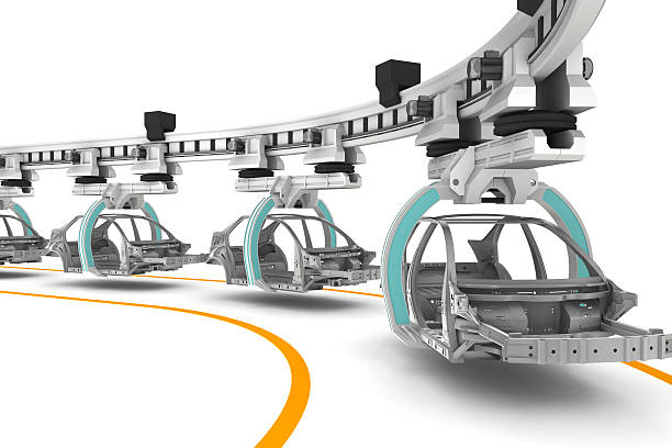 Line of cars being built on a white background stock photo