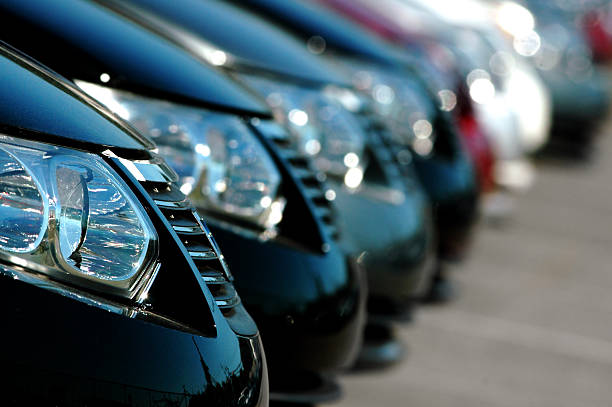 Line of Cars  car salesperson stock pictures, royalty-free photos & images