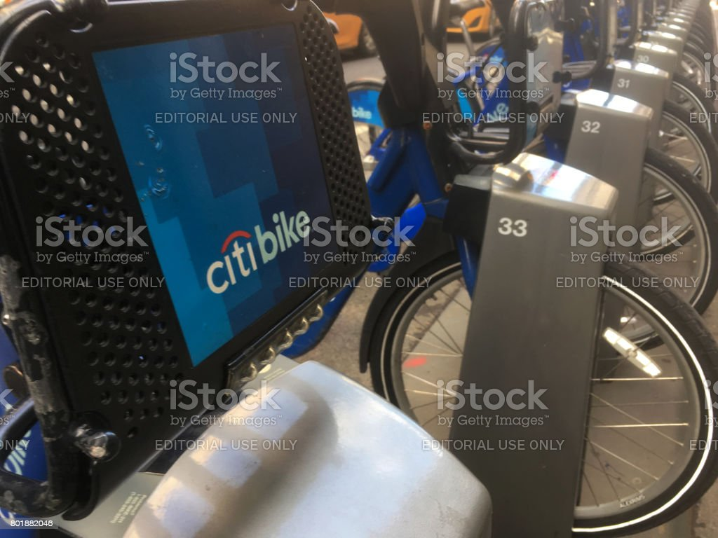 Line of Citi Bikes docked in Midtown Manhattan on 37th Street.  New York's bike share program as a transportation alternative. Citi Bike dock. stock photo