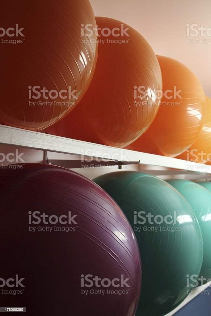 line of colored fitness balls stock photo