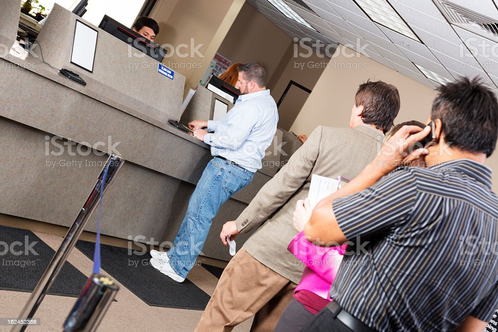 Line of customers at the bank stock photo