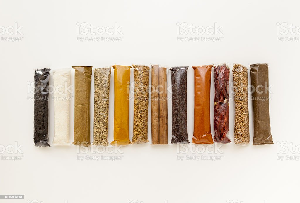 Line of Different Spices in Packets royalty-free stock photo