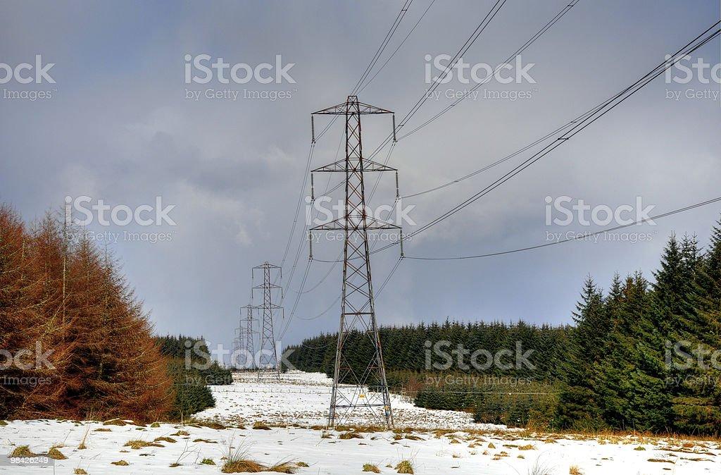 Linea di tralicci delle linee elettriche foto stock royalty-free