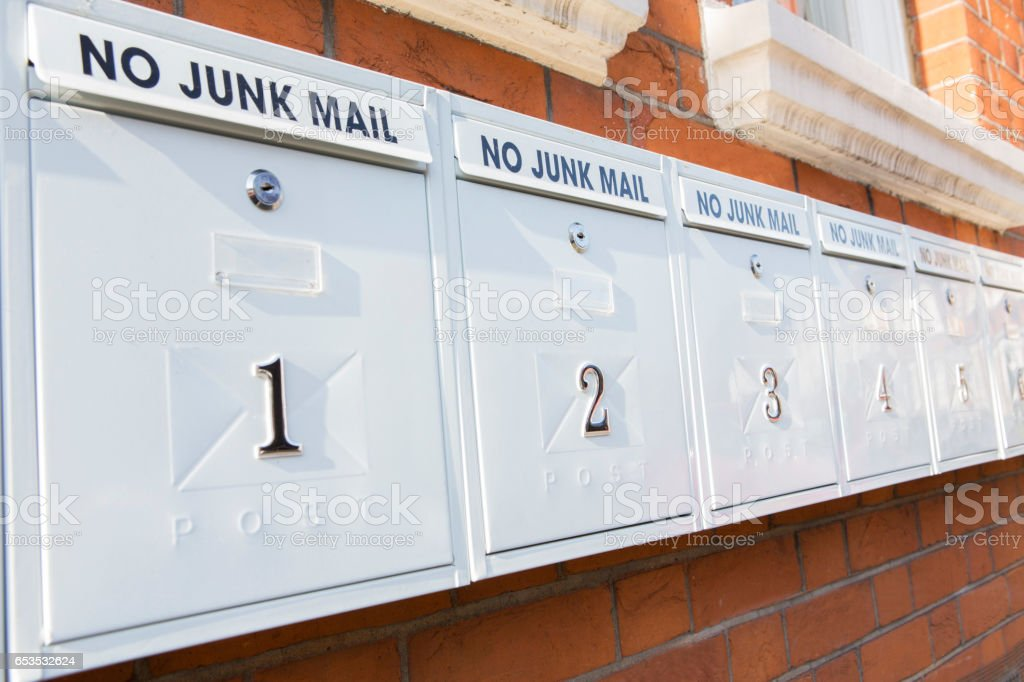 Line Of Mailboxes With No Junk Mail Notice stock photo