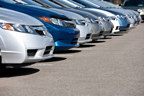 line of new compact cars at dealership. - in a row stock pictures, royalty-free photos & images