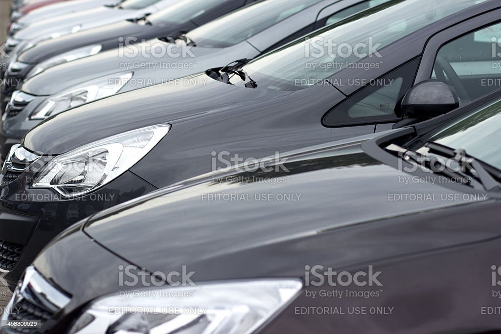Line of new Opel compact cars at dealership stock photo