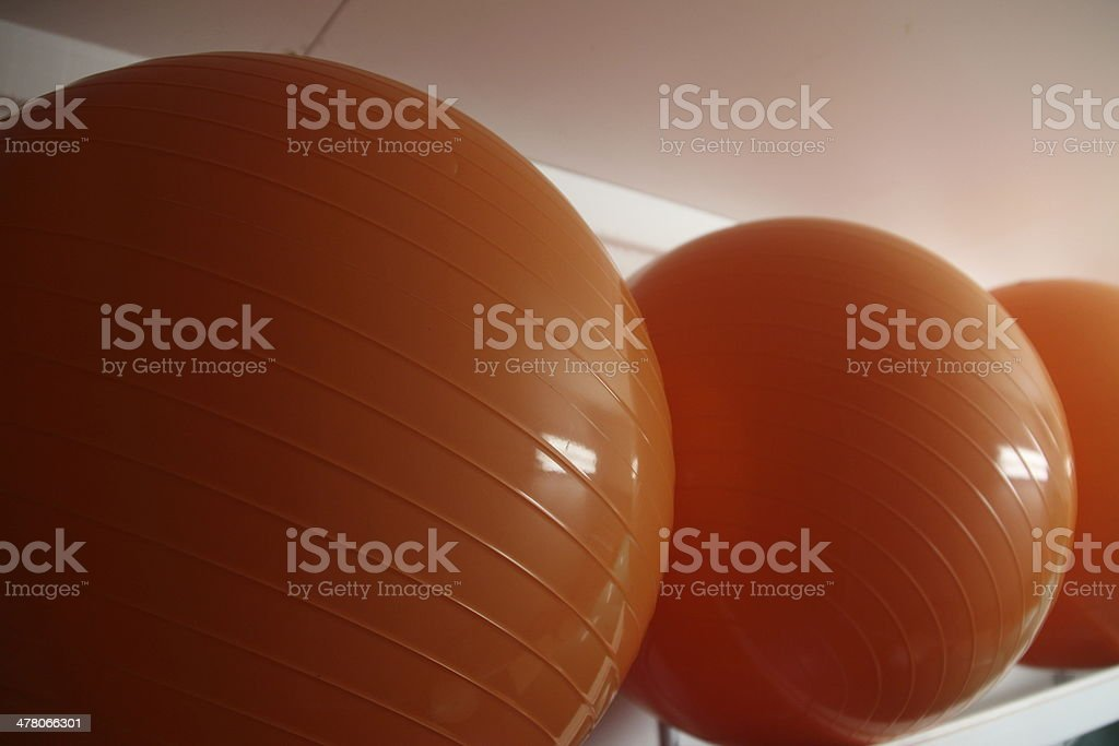line of orange colored fitness balls stock photo