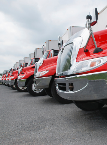 Line Of Parked Red And Shiny Trucks Stock Photo - Download Image Now