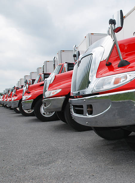 Line of parked red and shiny trucks row of red trucks. Check my transportation lightbox for more trucks. caravan photos stock pictures, royalty-free photos & images