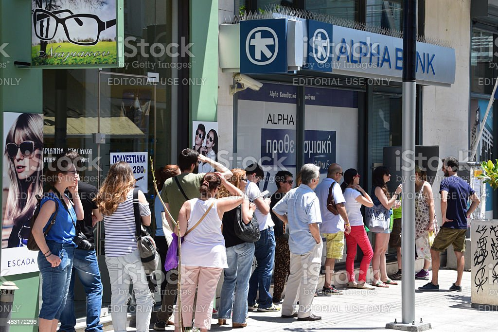 line of people atm cashpoint stock photo