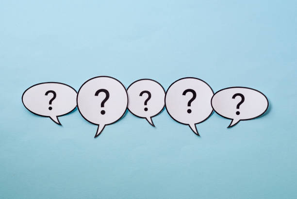 Line of question marks in speech bubbles stock photo