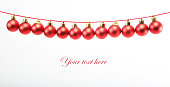 istock Line of red christmas balls on white 627044610