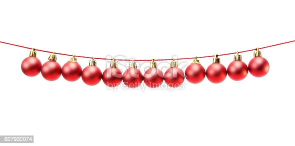 istock Line of red christmas balls on white 627932074