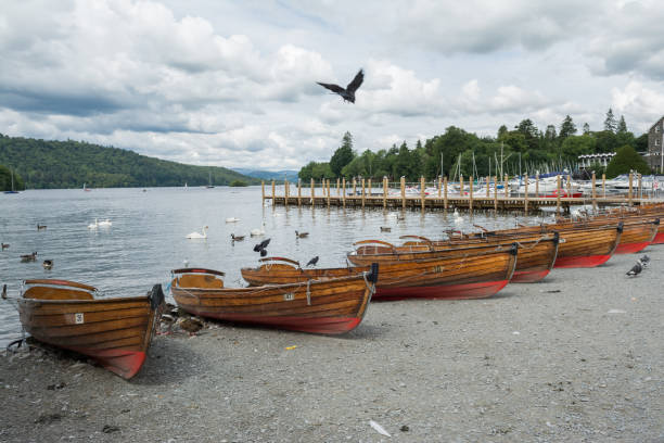 Line of rowing boats at Windermere shores stock photo