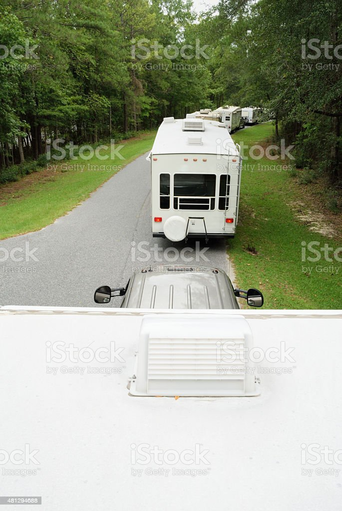 Line of rv travel trailers in campground stock photo