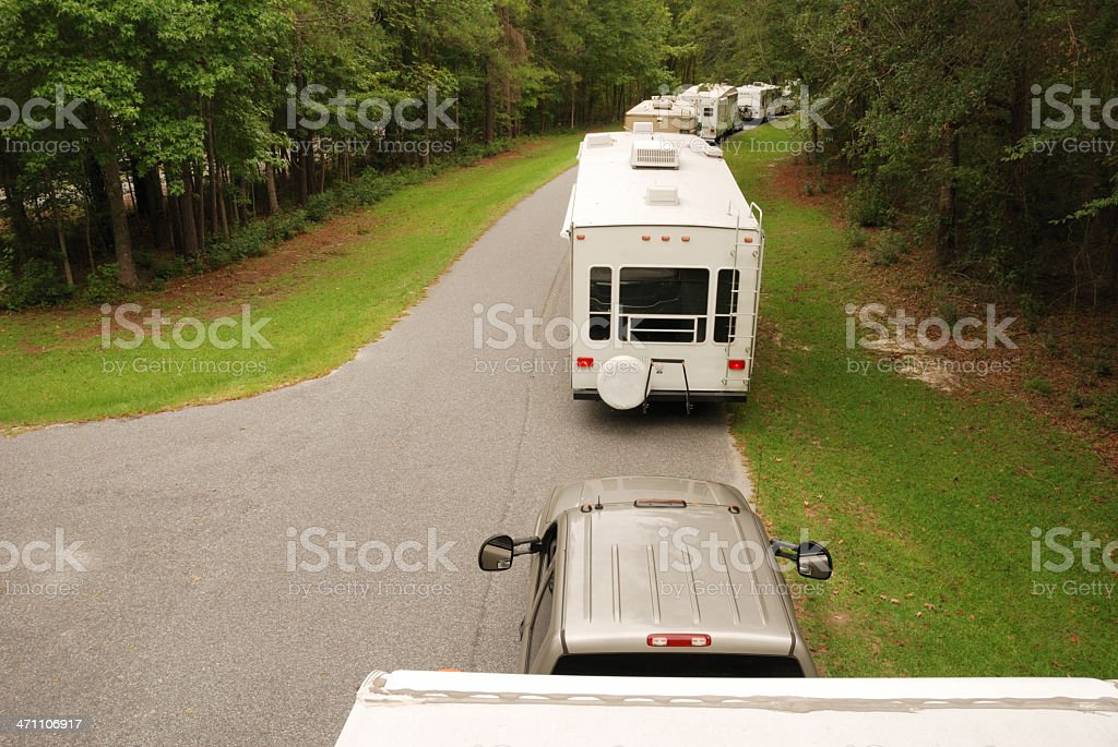 Line of RVs leaving campground stock photo