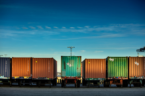 Line Of Shipping Containers On Trucks Stock Photo - Download Image Now