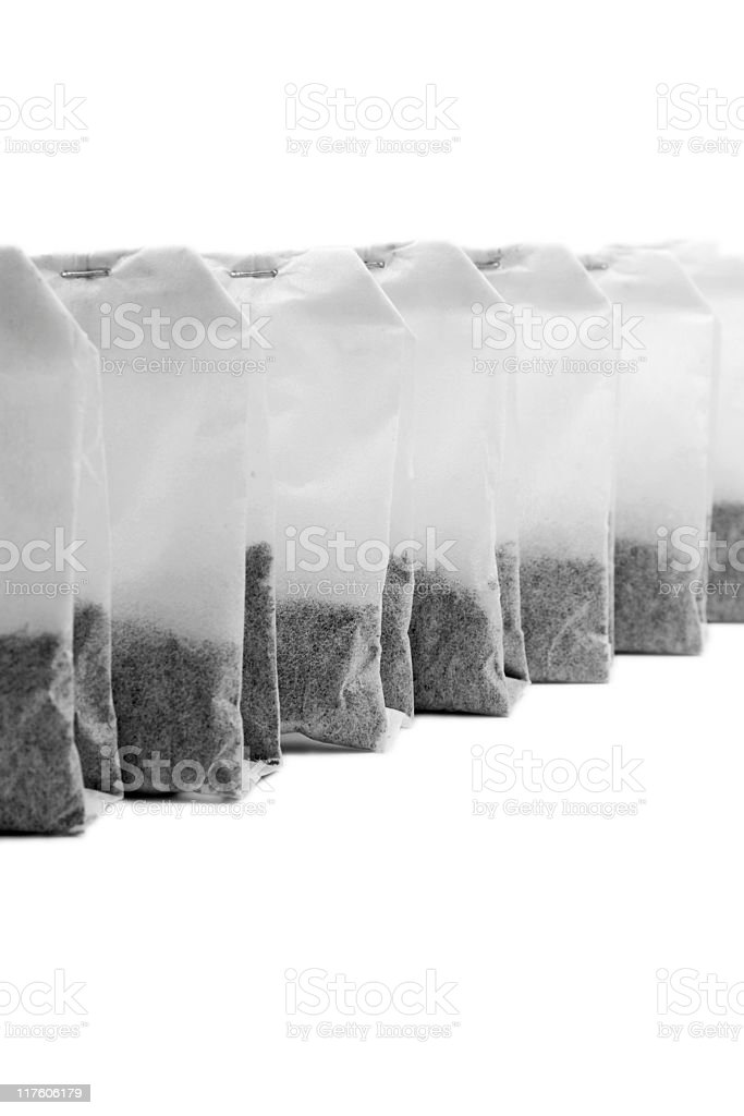 Line of Tea Bags isloated on a white background stock photo