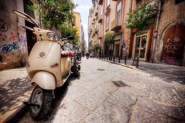 Line of Vespas on an Italian street in the summer Italian street scenic. Photo taken in Naples Italy. davelongmedia stock pictures, royalty-free photos & images