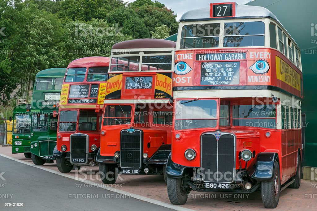 Line of vintage red and green vintage buses. stock photo