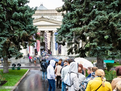 Moscow, Russia - July 31, 2019: line of visitors to entrace of Pushkin State Museum of Fine Arts on rainy day in Moscow city. Pushkin Museum is the museum of European art, located in Volkhonka street
