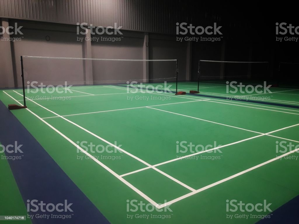 line on green badminton court stock photo