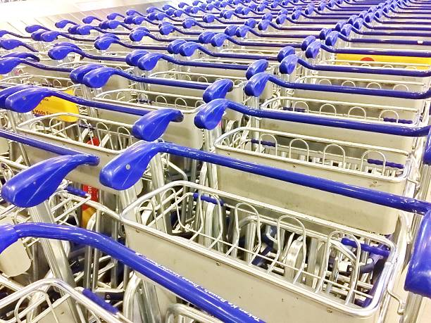Line stack of trolleys in the airport stock photo