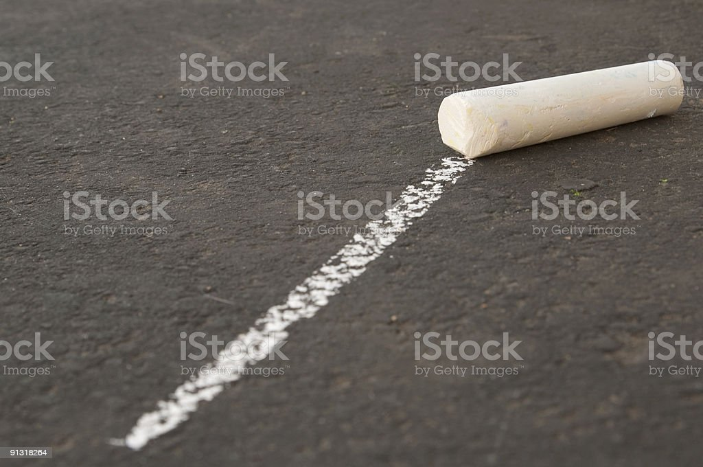 Line that leads to a single piece of chalk. royalty-free stock photo