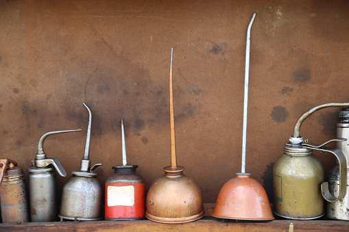 Rustic photo of vintage oil cans.