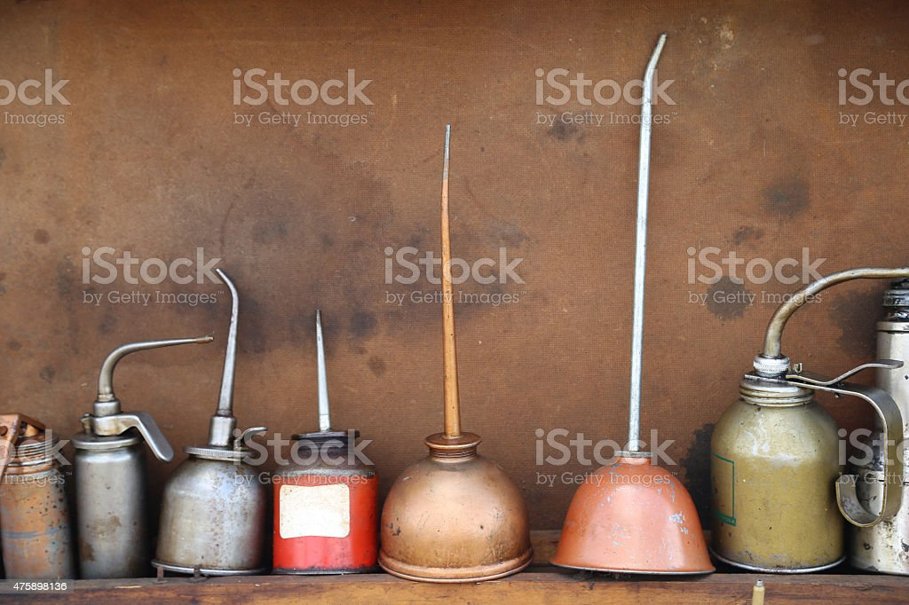 Line up of antique oil cans stock photo