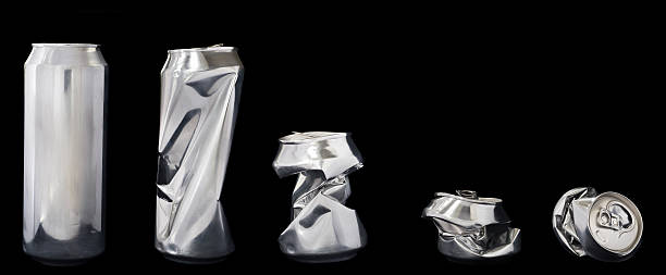 Line up of beer cans Silver metal / tin beer or soda can. crushed stock pictures, royalty-free photos & images