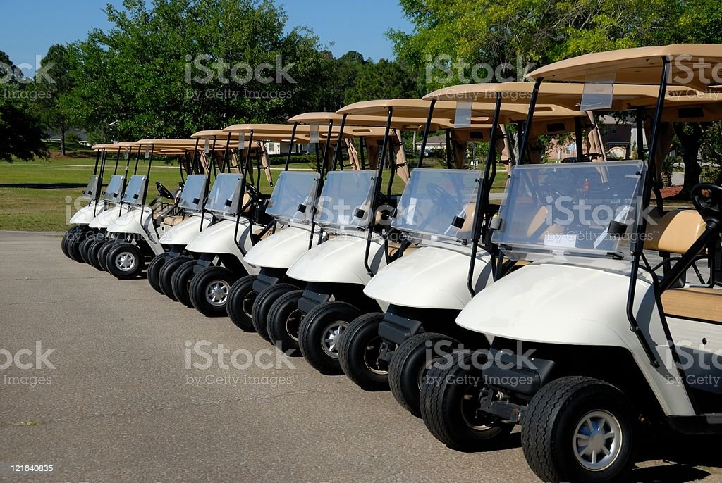 Line up of golf carts stock photo